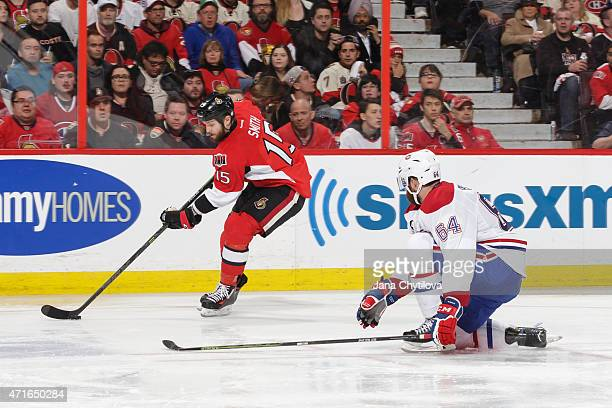 Zack Smith of the Ottawa Senators attempts to make a pass past the outstretched stick of Greg Pateryn of the Montreal Canadiens in Game Six of the...