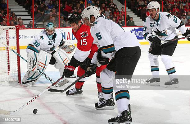 Zack Smith of the Ottawa Senators battles for a loose puck against Alex Stalock Jason Demers and Scott Hannan of the San Jose Sharks at Canadian Tire...