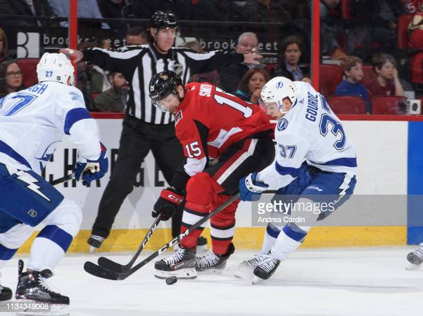 Zack Smith of the Ottawa Senators battles for a loose puck with Yanni Gourde of the Tampa Bay Lightning at Canadian Tire Centre on April 1 2019 in...