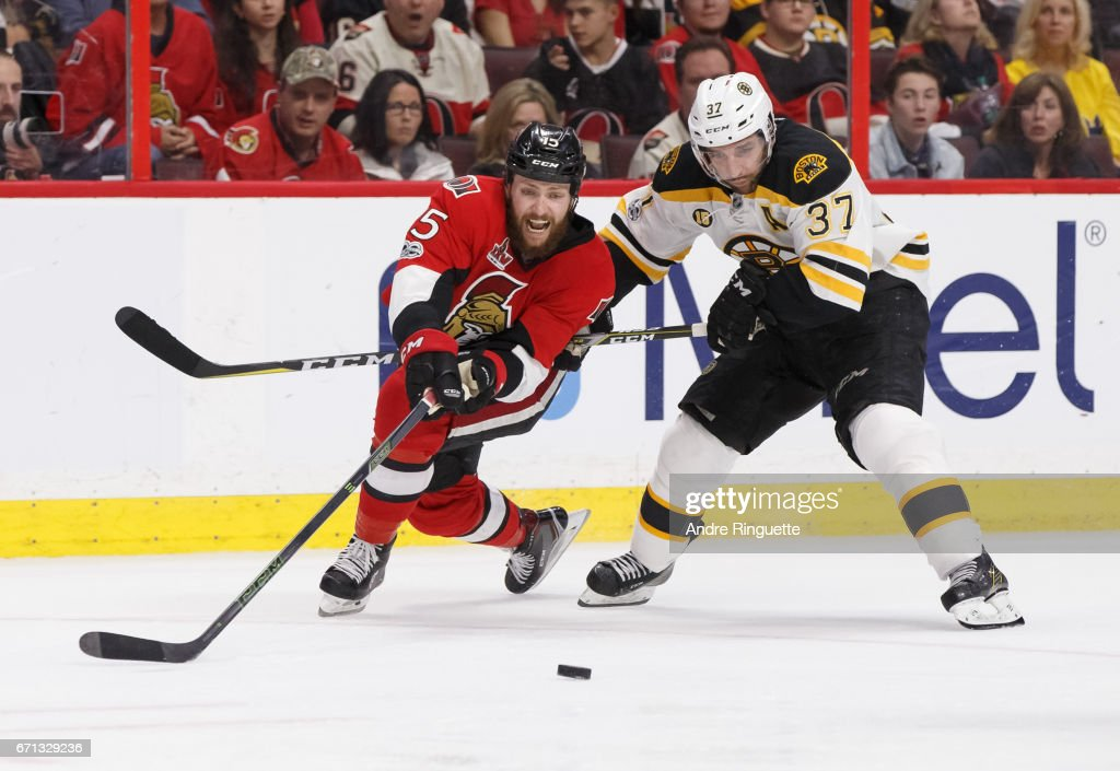 Zack Smith #15 of the Ottawa Senators battles for puck possession against Patrice Bergeron #37 of the Boston Bruins in Game Five of the Eastern Conference First Round during the 2017 NHL Stanley Cup Playoffs at Canadian Tire Centre on April 21, 2017 in Ottawa, Ontario, Canada.