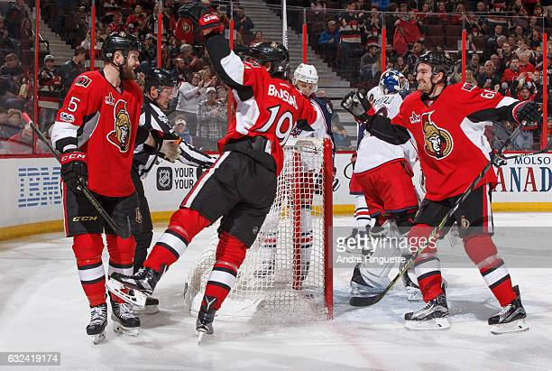 Zack Smith of the Ottawa Senators celebrates his first goal of the game against the Columbus Blue Jackets with teammates Derick Brassard and Mark...