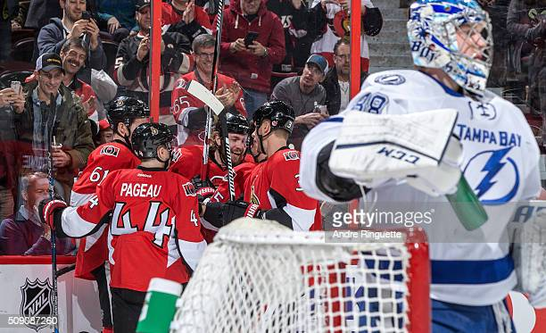 Zack Smith of the Ottawa Senators celebrates his first period goal against Andrei Vasilevskiy of the Tampa Bay Lightning with teammates Mark Stone...