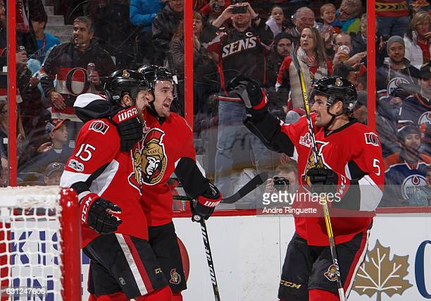 Zack Smith of the Ottawa Senators celebrates his first period goal against the Edmonton Oilers with teammates Mark Stone and Cody Ceci at Canadian...