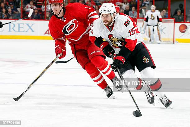 Zack Smith of the Ottawa Senators creates a breakaway opportunity after taking the puck from Noah Hanifin of the Carolina Hurricanes during an NHL...