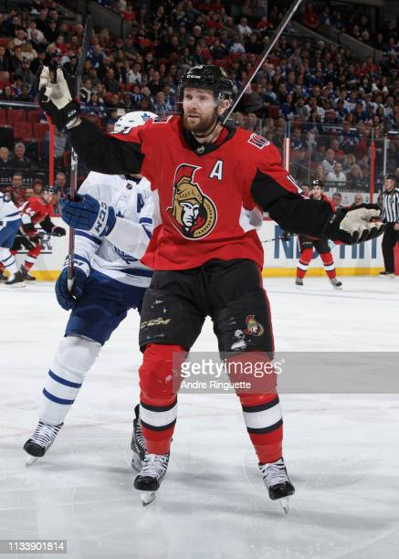 Zack Smith of the Ottawa Senators has his stick knocked out of his hands by John Tavares of the Toronto Maple Leafs at Canadian Tire Centre on March...