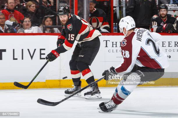 Zack Smith of the Ottawa Senators makes a saucer pass against Patrick Wiercioch of the Colorado Avalanche during an NHL game at Canadian Tire Centre...