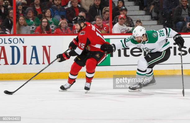 Zack Smith of the Ottawa Senators skates by Stephen Johns of the Dallas Stars with the puck at Canadian Tire Centre on March 16 2018 in Ottawa...