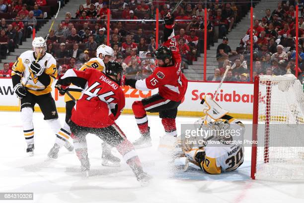 Zack Smith of the Ottawa Senators trips over Matt Murray of the Pittsburgh Penguins during the second period in Game Three of the Eastern Conference...