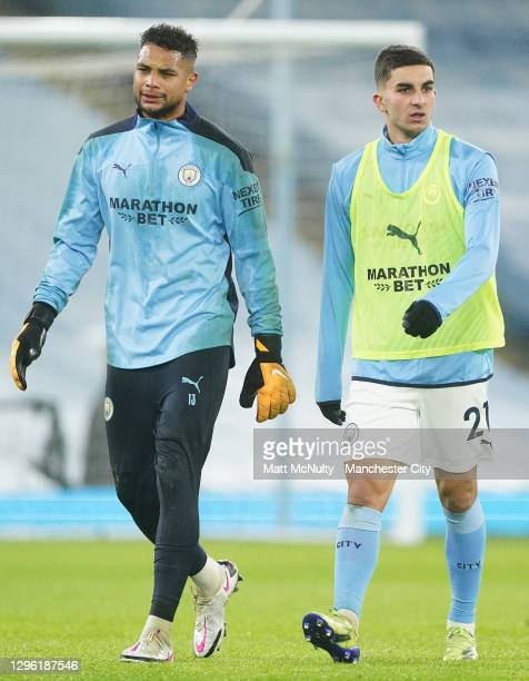 Zack Steffen and Ferran Torres of Manchester City look on as they warm up prior to the Premier League match between Manchester City and Brighton &...