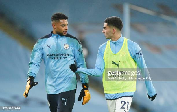 Zack Steffen and Ferran Torres of Manchester City warm up prior to the Premier League match between Manchester City and Brighton & Hove Albion at...