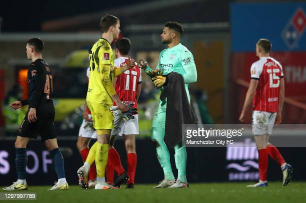 Zack Steffen of Manchester City and Josh Griffiths of Cheltenham Town interact after The Emirates FA Cup Fourth Round match between Cheltenham Town...