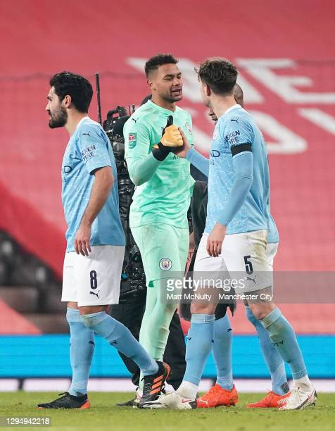 Zack Steffen of Manchester City celebrates with Ilkay Guendogan of Manchester City and John Stones of Manchester City after the Carabao Cup Semi...