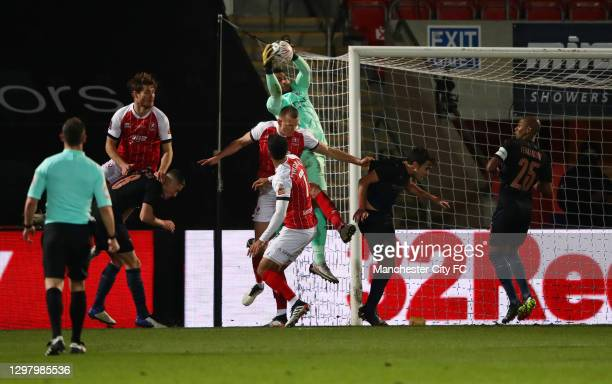 Zack Steffen of Manchester City comes to collect the high ball during The Emirates FA Cup Fourth Round match between Cheltenham Town and Manchester...