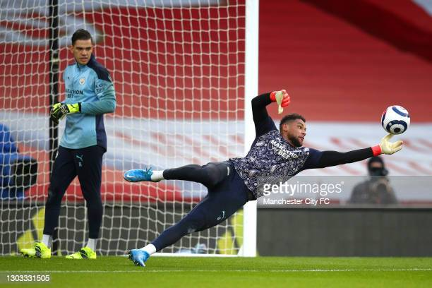 Zack Steffen of Manchester City makes a save during the warm up as team mate Ederson looks on prior to the Premier League match between Arsenal and...