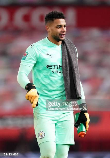 Zack Steffen of Manchester City walks off the pitch at half time during the Carabao Cup Semi Final match between Manchester United and Manchester...