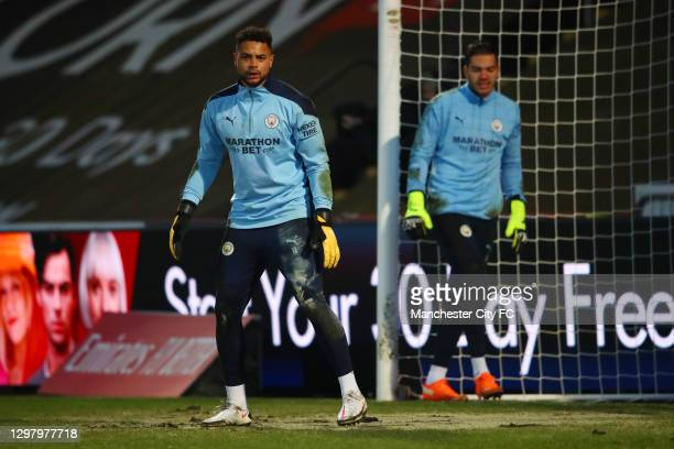 Zack Steffen of Manchester City warms up prior to The Emirates FA Cup Fourth Round match between Cheltenham Town and Manchester City at Jonny Rocks...