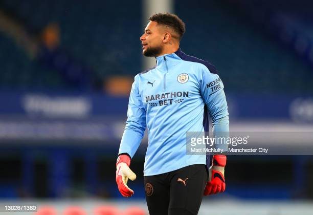 Zack Steffen of Manchester City warms up prior to the Premier League match between Everton and Manchester City at Goodison Park on February 17, 2021...