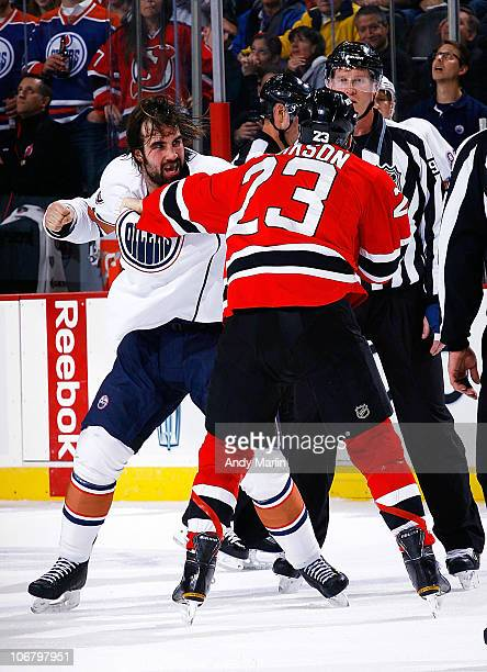 Zack Stortini of the Edmonton Oilers and David Clarkson of the New Jersey Devils get into a fight during the game at the Prudential Center on...