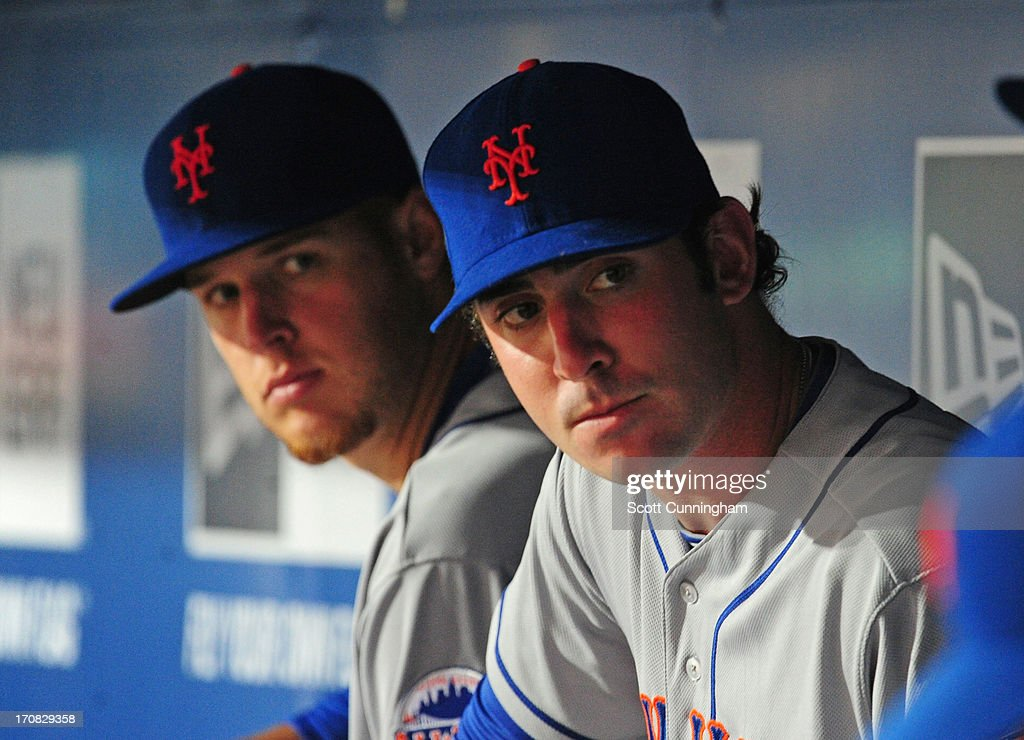 Zack Wheeler #45 (L) and Matt Harvey #33 of the New York Mets relax in the dugout during game two of a doubleheader against the Atlanta Braves at Turner Field on June 18, 2013 in Atlanta, Georgia.