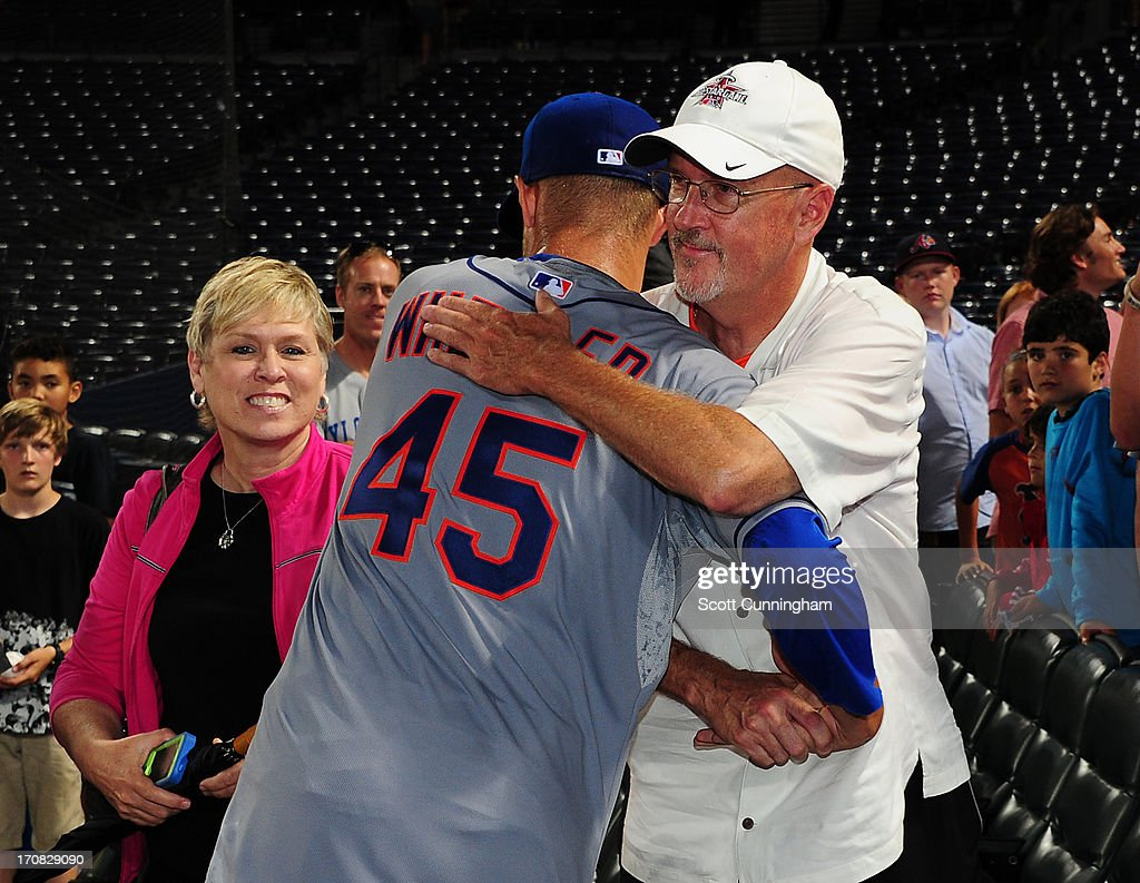 Zack Wheeler #45 of the New York Mets celebrates with his parents after game two of a doubleheader against the Atlanta Braves at Turner Field on June 18, 2013 in Atlanta, Georgia.