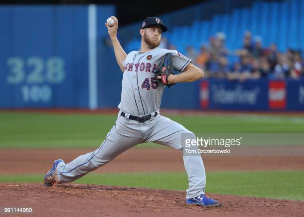 Zack Wheeler of the New York Mets delivers a pitch in the second inning during MLB game action against the Toronto Blue Jays at Rogers Centre on July...