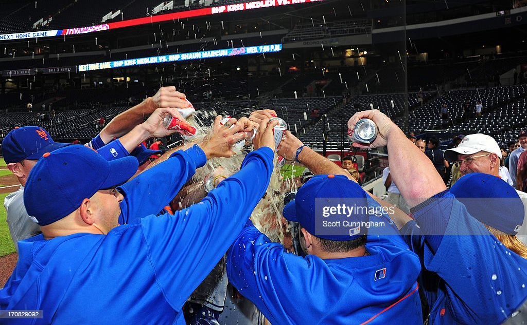 Zack Wheeler #45 of the New York Mets is doused with a beer shower after game two of a doubleheader against the Atlanta Braves at Turner Field on June 18, 2013 in Atlanta, Georgia.