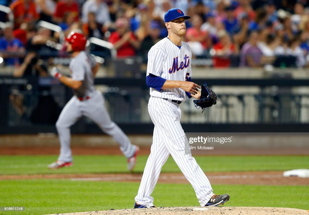 Zack Wheeler #45 of the New York Mets looks on after surrendering a sixth inning two run home run against #11 of the St. Louis Cardinals on July 17, 2017 at Citi Field in the Flushing neighborhood of the Queens borough of New York City.