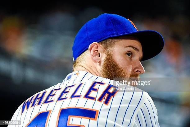 Zack Wheeler of the New York Mets looks on during a game against the Miami Marlins at Citi Field on September 17 2014 in the Flushing neighborhood of...