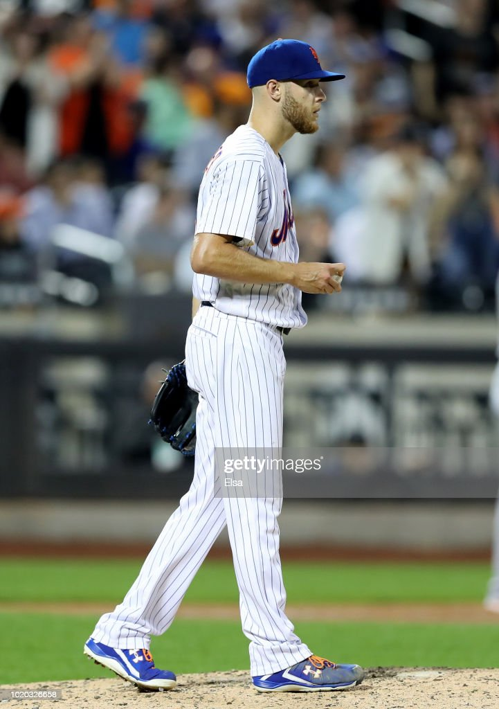 Zack Wheeler #45 of the New York Mets reacts after a run is scored in the seventh inning against the San Francisco Giants on August 20, 2018 at Citi Field in the Flushing neighborhood of the Queens borough of New York City.