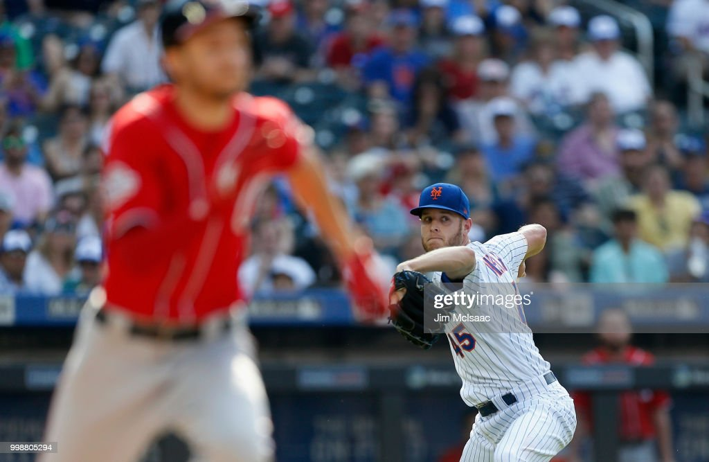 Zack Wheeler #45 of the New York Mets throws out Trea Turner #7 of the Washington Nationals after a bunt attempt in the fifth inning at Citi Field on July 14, 2018 in the Flushing neighborhood of the Queens borough of New York City.