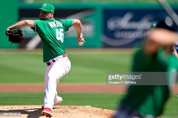 Zack Wheeler of the Philadelphia Phillies throws a pitch during the first inning against the Detroit Tigers during a spring training game at BayCare...