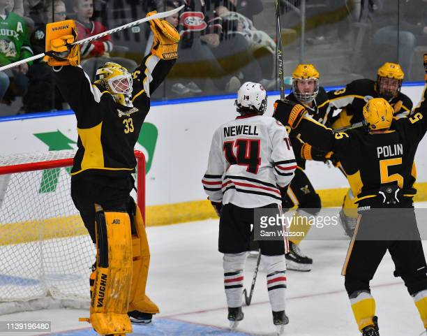 Zackarias Skog and Ryan Polin of the American International Yellow Jackets celebrate after the Yellow Jackets defeated the St Cloud State Huskies 21...