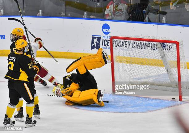 Zackarias Skog of the American International Yellow Jackets lays on the ice after Liam Finlay of the Denver Pioneers scored a goal in the third...