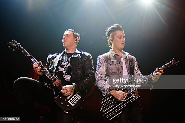 Zacky Vengeance and Synyster Gates of Avenged Sevenfold performs on stage at Phones 4 U Arena on November 30 2013 in Manchester United Kingdom