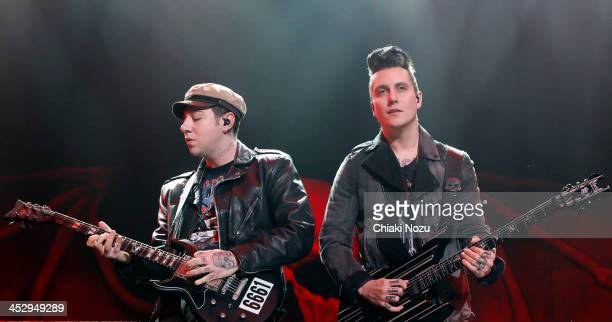 Zacky Vengence and Synyster Gates of Avenged Sevenfold perform at Wembley Arena on December 1 2013 in London England