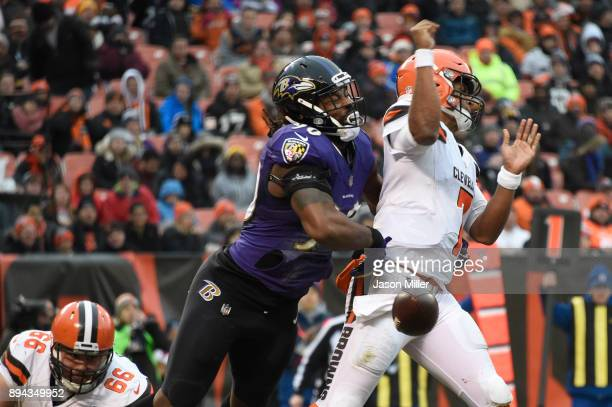 Za'Darius Smith of the Baltimore Ravens causes DeShone Kizer of the Cleveland Browns to fumble the ball in the third quarter at FirstEnergy Stadium...