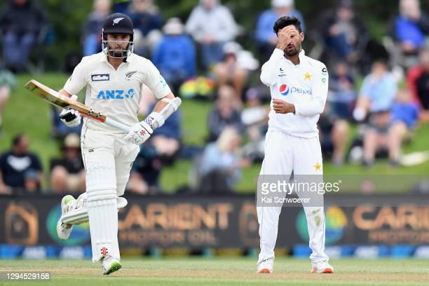 Zafar Gohar of Pakistan reacts as Kane Williamson of New Zealand makes a run during day three of the Second Test match in the series between New...