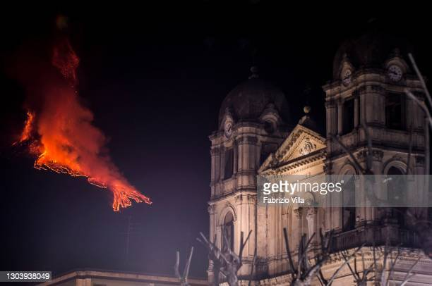 Zafferana Etnea's Mother Church is lit in the shadow of Mount Etna, which has been spewing lava, ash and volcanic rock on a regular basis for over a...
