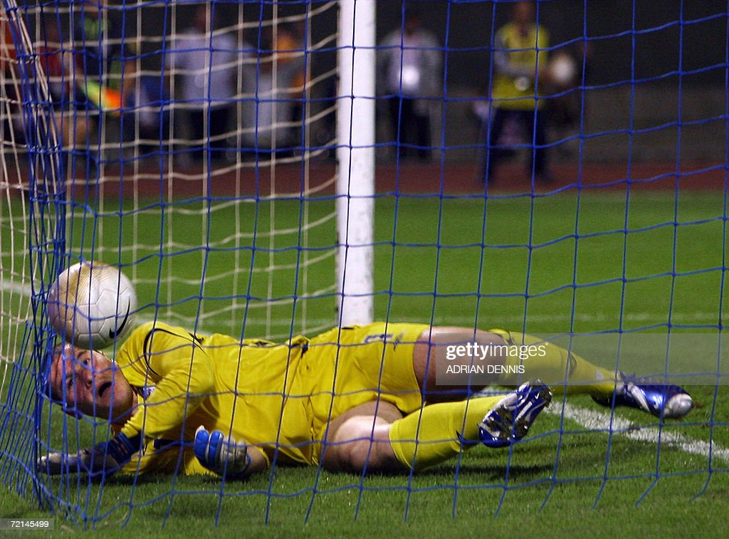 England's goalkeeper Paul Robinson lies in his goal after a looping header by Croatia's Eduardo Da Silva to score the opening goal during the Group E Euro 2008 qualifying match at Maksimir Stadium in Zagreb 11 October 2006. Croatia won the game 2-0 with Robinson missing a kick which rolled in for Croatia's second goal.
