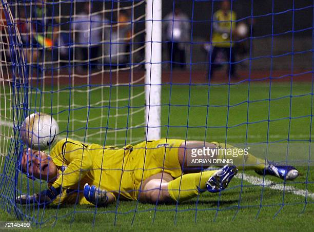 England's goalkeeper Paul Robinson lies in his goal after a looping header by Croatia's Eduardo Da Silva to score the opening goal during the Group E...