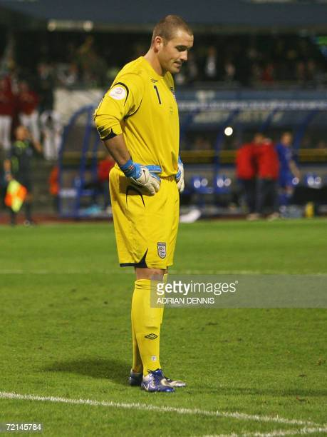 England's goalkeeper Paul Robinson looks at the ground after missing a kick which then rolled into the goal for Croatia's second goal during the...