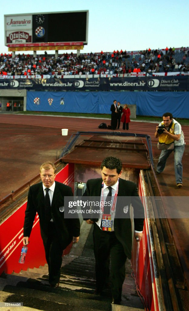 England's Manager Steve McLaren (L) and Communications Officer Adrian Bevington (R) enter the stadium from the underground tunnel ahead of their Group E Euro2008 qualifying football match against Croatia at Maksimir Stadium in Zagreb, 11 October 2006.