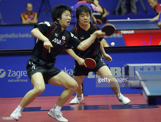 Seiya Kishakava and Jun Mizutani of Japan compete with Hao Shuai and Ma Long of China during their third round double match at the 49th World Table...