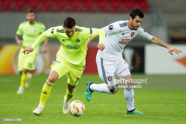 Zagrebs Bosnian midfielder Amer Gojak and Trnavas Czech midfielder Jakub Rada vie for the ball during the UEFA Europa League group D football match...