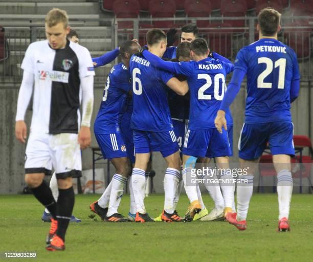 Zagreb's players celebrate after scoring during the UEFA Europa League group K football match Wolfsberg v Dinamo Zagreb in Klagenfurt, Austria, on...