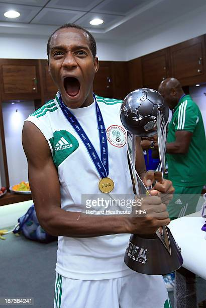 Zaharaddeen Bello of Nigeria celebrates with the trophy after Nigeria win 30 during the FIFA U17 World Cup UAE 2013 Final between Nigeria and Mexico...