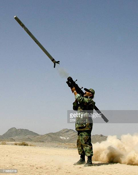 An Iranian soldier shoots a missile during the tree days of the military manoeuvres at SistanBaluchestan province east of city of Zahedan near the...