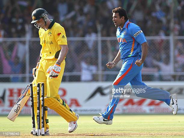 Zaheer Khan of India celebrates after taking the wicket of Michael Hussey of Australia during the 2011 ICC World Cup Quarter Final match between...