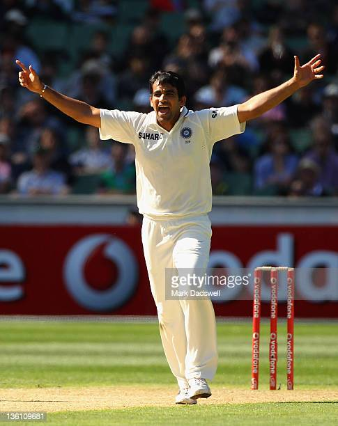 Zaheer Khan of India celebrates bowling Michael Clarke of Australia during day one of the First Test match between Australia and India at Melbourne...