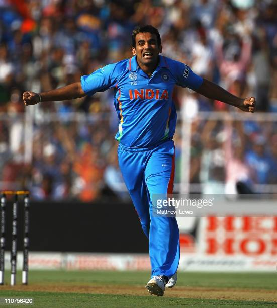 Zaheer Khan of India celebrates bowling Michael Hussey of Australia during the 2011 ICC World Cup Quarter Final match between Australia and India at...